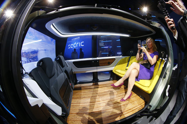 People take pictures inside Volkswagen Sedric concept car is seen during the 87th International Motor Show at Palexpo in Geneva, Switzerland March 6, 2017. (Photo by Arnd Wiegmann/Reuters)
