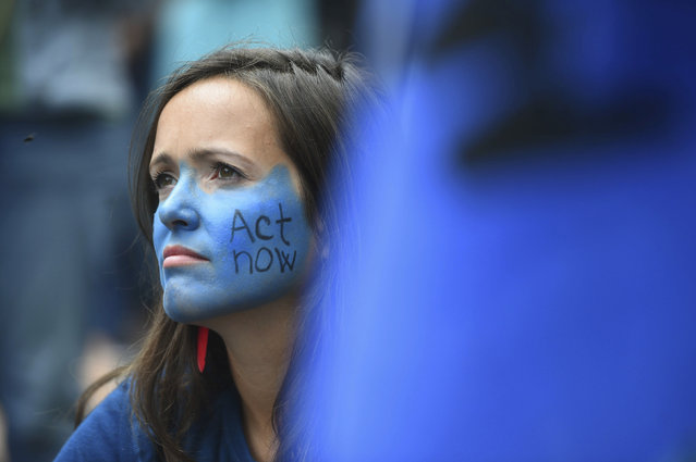 """Protesters from from the environmental pressure group Extinction Rebellion demonstrate outside the Royal Courts of Justice in London, Monday July 15, 2019.  Environmental campaigners are blocking some roads across the UK on Monday, as they protest against what they allege is """"inaction"""" on climate change. (Photo by Kirsty O'Connor/PA via AP Photo)"""