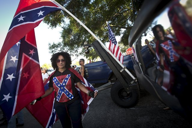 "A woman who declined to give her name, poses for a photo and is reflected in a bumper of a lifted pick up truck before a ""Ride for Pride"" impromptu event to show support for the Confederate flag in Brandon, Hillsborough County, June 26, 2015. (Photo by Carlo Allegri/Reuters)"