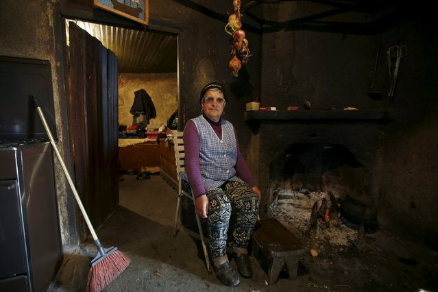 Maria Fontes poses for a portrait inside her house in Agracoes, near Chaves, Portugal April 18, 2016. (Photo by Rafael Marchante/Reuters)