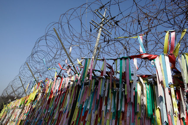Pro-unification messages hang on the barbed wire at the Imjingak, near the Demilitarized zone (DMZ) separating South and North Korea