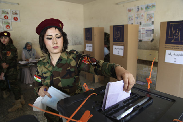 A member of Kurdish security forces casts her ballot inside a polling station during early voting for the parliamentary election in Arbil, in Iraq's Kurdistan region, April 28, 2014. (Photo by Azad Lashkari/Reuters)