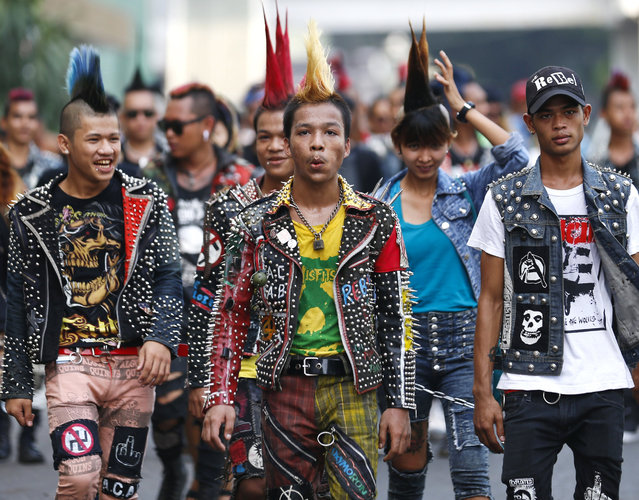 Myanmar punks walk in the downtown area as they take part in a punk gathering ahead of the Thingyan water festival in Yangon, Myanmar, 12 April 2017. Myanmar punks have been gathering in Yangon on the day ahead of Thingyan water festival to celebrate every year. The annual water festival is marked with large groups of people congregating to celebrate by splashing water and throwing powder at each others faces as a symbolic sign of cleansing and washing away the sins from the old year to mark the traditional New Year in countries such as Myanmar, Thailand, Laos and Cambodia. This year, the Myanmar Thingyan water festival falls on 13 April and ends on 16 April. (Photo by Lynn Bo Bo/EPA)