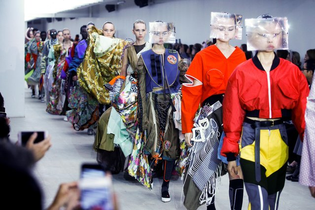 Models present creations during the Matty Bovan catwalk show during London Fashion Week in London, Britain, September 13, 2019. (Photo by Henry Nicholls/Reuters)