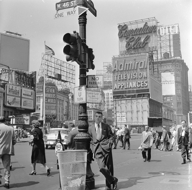 A salesman bides his time in Times Square, Manhattan, New York, 1950