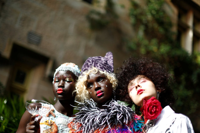 Models pose against the backdrop of an old sandstone chapel during a fashion show for the label Romance Was Born on the waterfront of Sydney Harbour during Australian Fashion Week, Sydney, Australia May 18, 2016. (Photo by Jason Reed/Reuters)