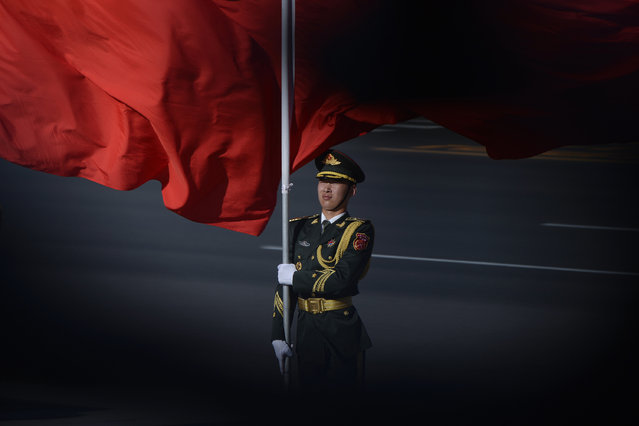 Chinese honour guards prepare for the arrival of  Vietnamese President Tran Dai Quang and Chinese President Xi Jinping during a welcome ceremony at the Great Hall of the People in Beijing on May 11, 2017. Tran Dai Quang is on a visit to China and will attend the Belt and Road Forum for International Cooperation from May 11 to 15. (Photo by Wang Zhao/AFP Photo)