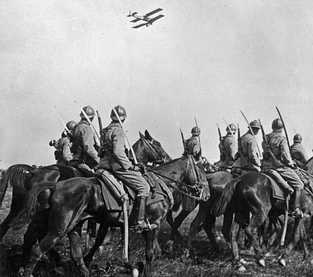 French Cavalry observe an Army airplane fly past. (Photo by Keystone View Company via The Atlantic)