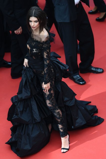 "US actress and model Emily Ratajkowski poses as she arrives on May 18, 2017 for the screening of the film ""Loveless"" (Nelyubov) at the 70th edition of the Cannes Film Festival in Cannes, southern France. (Photo by Anne-Christine Poujoulat/AFP Photo)"