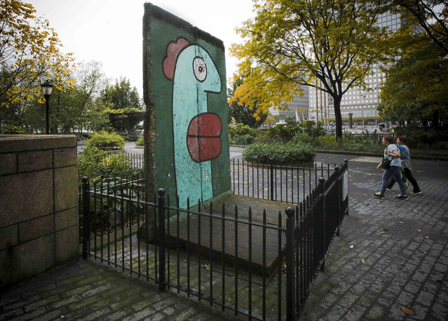 In this photo taken Wednesday October 30, 2019 section of the Berlin Wall is shown installed on the Kowsky Plaza in New York's Battery Park. (Photo by Bebeto Matthews/AP Photo)