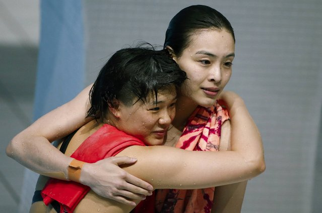 First placed China's Shi Tingmao and Wu Minxia react after the women's synchronized 3m springboard final at the Aquatics World Championships in Kazan, Russia, July 25, 2015. (Photo by Stefan Wermuth/Reuters)