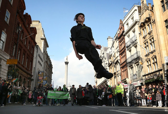 A traditional Irish dancer leaps during a St Patrick's day parade on March 18, 2012 in London