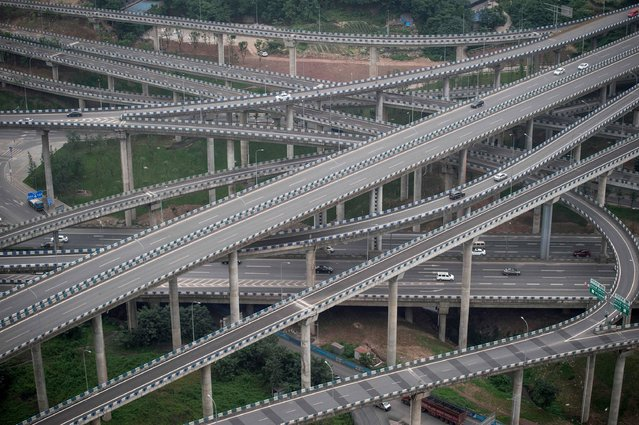 Motorists drive on an interchange in Chongqing, southwest China, on June 3, 2017. The interchange is made up of five layers, 20 ramps and goes in eight different directions. (Photo by Fred Dufour/AFP Photo)