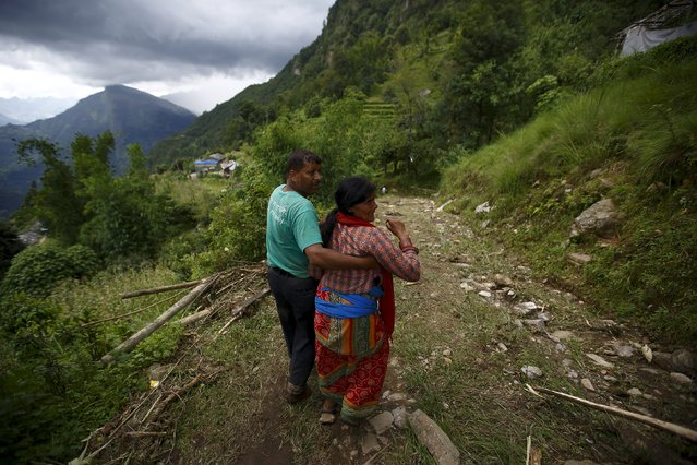 A family member cries after a dead body is recovered from the landslide at Lumle village in Kaski district July 30, 2015. (Photo by Navesh Chitrakar/Reuters)