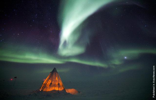 The aurora australis provides a dramatic backdrop to a Scott Tent at Amundsen-Scott South Pole Station on July 14, 2009