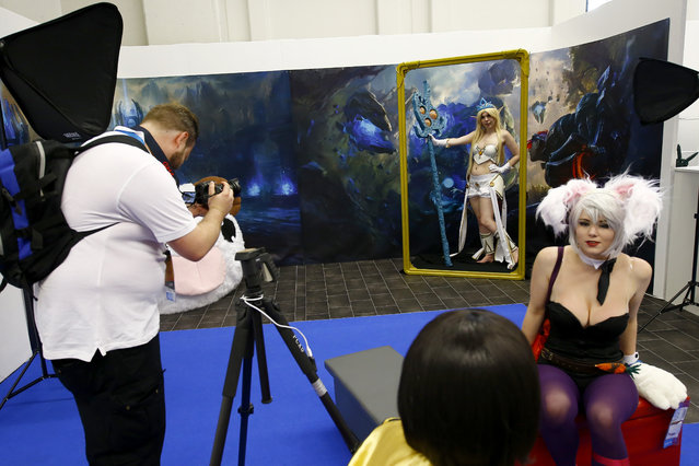 A cosplayer poses for a photo during the Gamescom 2015 fair in Cologne, Germany August 5, 2015. (Photo by Kai Pfaffenbach/Reuters)