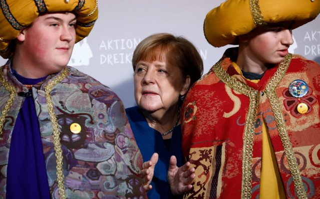 German Chancellor Angela Merkel (CDU), receives the Epiphany Singers from different regions of the federal republic in the chancellery on January 7, 2020 in Berlin, Germany. (Photo by Michele Tantussi/Getty Images)