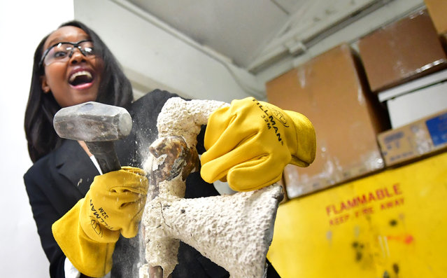 """Actress Ashleigh LaThrop reacts while breaking the mould of the statue of the Screen Actors Guild (SAG) Award known as """"the Actor"""" at the American Fine Arts Foundry on January 7, 2020 in Burbank, California, where the statues are made for presentation to winners at the 26th Screen Actors Guild (SAG) Awards which takes place on January 19, 2020 in Los Angeles. (Photo by Frederic J. Brown/AFP Photo)"""