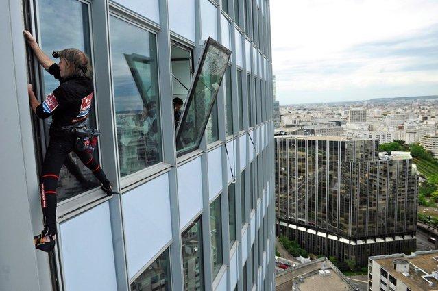 Alain Robert Climbs The First Tower In Paris