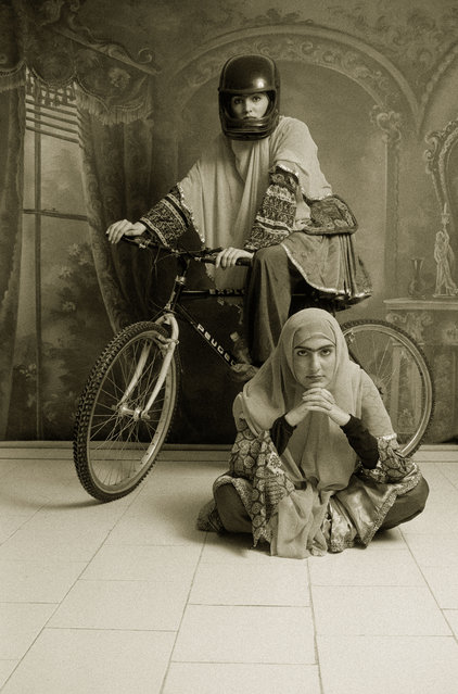 """From Qajar"", 1998. Shadi Ghadirian's first series, Qajar, featured portraits of women with backdrops and dress drawn from the Qajar era (1785-1925). She then added contemporary western elements – a boombox, a Pepsi can or, in this case, a bike. (Photo by Shadi Ghadirian/The Guardian)"