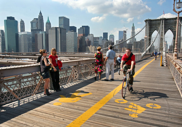 A cyclist rides on the Brooklyn Bridge in New York City, New York, on September 7, 2006. The skyline of lower Manhattan was forever changed when the twin towers of the World Trade Center were destroyed in terrorist attack five years ago. (Photo by Melanie Stetson Freeman/The Christian Science Monitor via Getty Images)