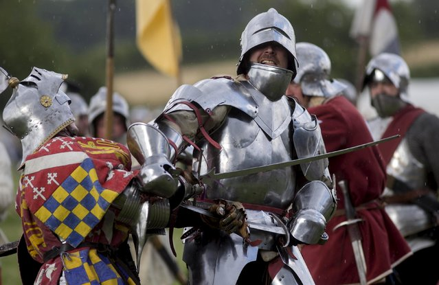 Historical re-enactors recreate a mock battle as part of an anniversary event for the Battle of Bosworth near Market Bosworth in central Britain August 22, 2015. (Photo by Neil Hall/Reuters)