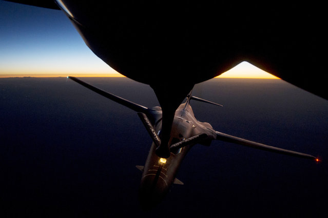 A U.S. Air Force B-1B Lancer supersonic bomber receives fuel from a KC-135 Stratotanker over northern Iraq after conducting air strikes in Syria against ISIL targets September 27, 2014. (Photo by Reuters)