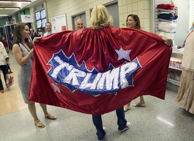 A man wearing a Trump cape talks to people during the second day of the Republican National Convention in Cleveland, Ohio, U.S. July 19, 2016. (Photo by Aaron Josefczyk/Reuters)