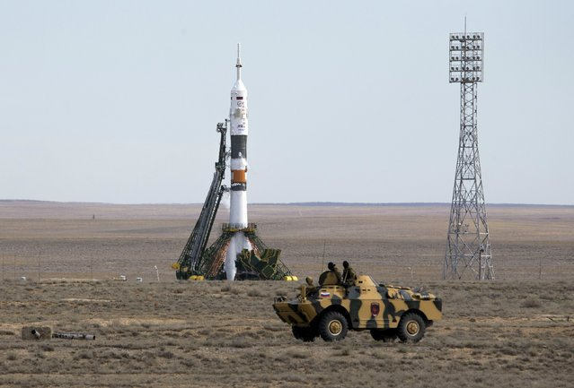 An armoured personnel carrier (APC) drives in front of the Soyuz TMA-18M spacecraft shortly before the launch with the international crew at the Baikonur cosmodrome, Kazakhstan, September 2, 2015. (Photo by Shamil Zhumatov/Reuters)