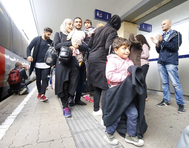 Migrants disembark from a train at a railway station in Vienna, Austria September 5, 2015. (Photo by Dominic Ebenbichler/Reuters)