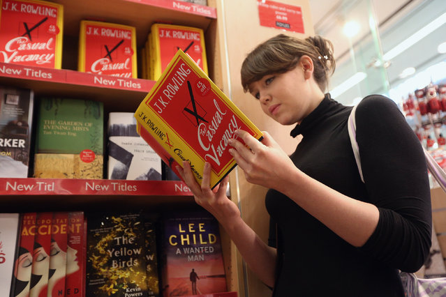 A woman at Foyles bookshop looks at a copy of J. K. Rowling's latest novel 'The Casual Vacancy' which has gone on sale today starting at 8:00 am on September 27, 2012 in London, England.  'The Casual Vacancy' is J. K. Rowling's first book aimed at an adult readership and is centered on a parish council election in a small West Country town.  (Photo by Oli Scarff)