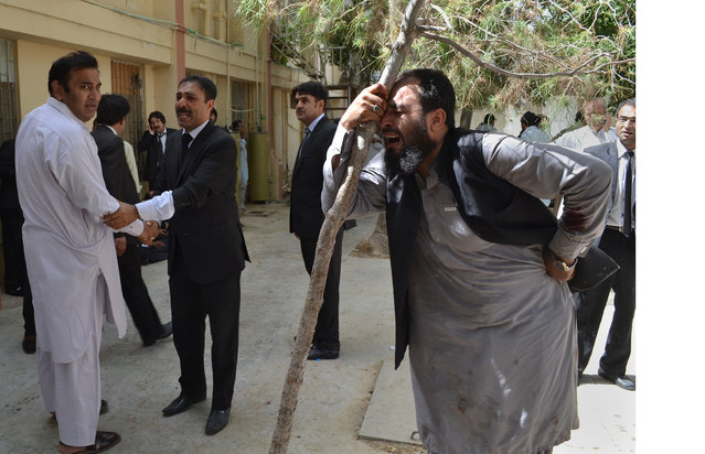 Pakistani lawyers mourn the deaths of their colleagues following a bomb blast in Quetta, Pakistan, Monday, August 8, 2016. (Photo by Arshad Butt/AP Photo)