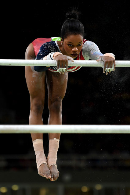 Gabrielle Douglas of the United States competes on the uneven bars during the Artistic Gymnastics Women's Team Final on Day 4 of the Rio 2016 Olympic Games at the Rio Olympic Arena on August 9, 2016 in Rio de Janeiro, Brazil. (Photo by Laurence Griffiths/Getty Images)