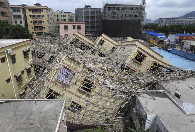 A general view shows a collapsed building in Zhuhai, Guangdong province, March 21, 2011. (Photo by Reuters/China Daily)