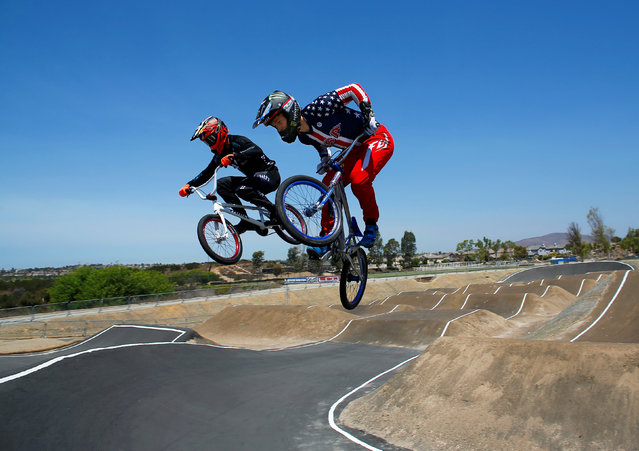 U.S. Olympic BMX athlete Connor Fields (R) goes over a jump as he trains with New Zealand's Trent Jones at the Olympic Training Center in Chula Vista, California, United States, July 23, 2016. (Photo by Mike Blake/Reuters)