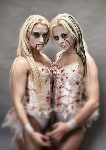 The Sinister Sisters, Steph Bates (L) and Steph Randall (R) pose for a photograph prior to a rehearsal of the Circus of Horrors' latest show The Night of the Zombie at the Wookey Hole Caves Theatre near Wells on October 23, 2014 in Somerset, England. (Photo by Matt Cardy/Getty Images)
