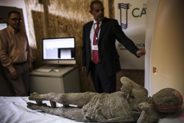 A working team appointed by the Archaeological Superintendence of Pompeii performs a Cat scan (Computerized axial tomography) one out of thirty casts of victims of the eruption of Vesuvius in 79 AD in Pompeii, in Napoli, Italy, 29 September 2015. (Photo by Cesare Abbate/EPA)