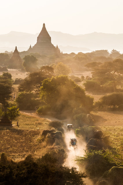 """""""Horse and Cart"""". There is nothing more awe inspiring as watching the sunrise and set from the top of one of the temples in the central plain in Bagan. Back in the day, the Kings of Bagan commissioned the construction of some 4000 Buddhist Temples, but only around half remain standing today… but what a sight they are. Photo location: Bagan, Myanmar. (Photo and caption by Andy Ferrington/National Geographic Photo Contest)"""
