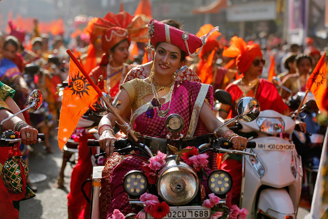 Women dressed in traditional costumes ride motorbikes as they attend celebrations to mark the Gudi Padwa festival, the beginning of the New Year for Maharashtrians, in Mumbai, India March 28, 2017. (Photo by Shailesh Andrade/Reuters)