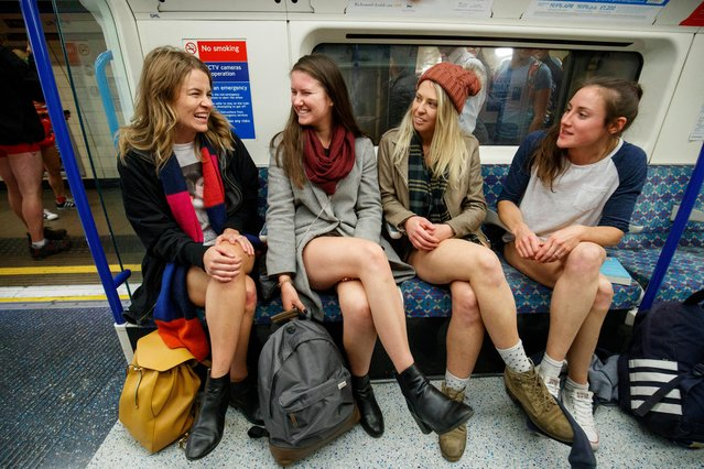 Passengers wear no trousers as they ride the London Underground in London, Britain, 07 January 2018. (Photo by Tolga Akmen/EPA/EFE)