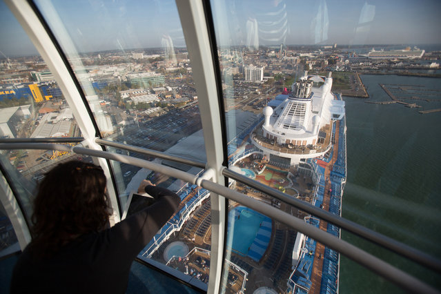 A visitor takes a photograph from the North Star observation capsule onboard the cruise ship Quantum of the Seas which is currently docked at Southampton on October 31, 2014 in Southampton, England. (Photo by Matt Cardy/Getty Images)