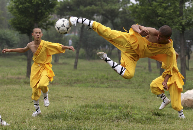 Shaolin students play soccer at Tagou Wushu School in Zhengzhou, Henan province. (Photo by Donald Chan/Reuters)