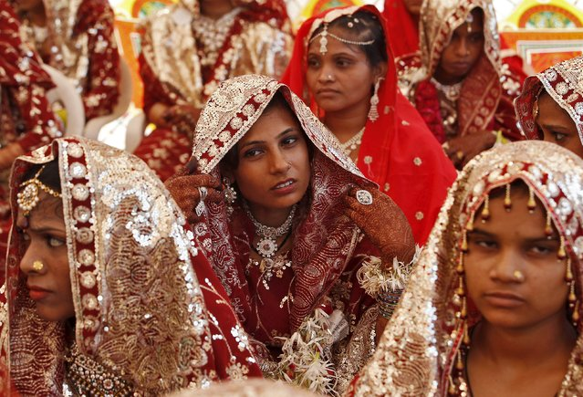 Muslim brides wait for the start of a mass marriage ceremony in Ahmedabad, India, October 11, 2015. (Photo by Amit Dave/Reuters)
