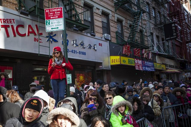 Parade-goers lined the streets of New York's Chinatown during the 14th Annual Chinatown Lunar New year Parade on February 17, 2013 in New York City. This year celebrates the Year of the Snake. (Photo by Michael Nagle)