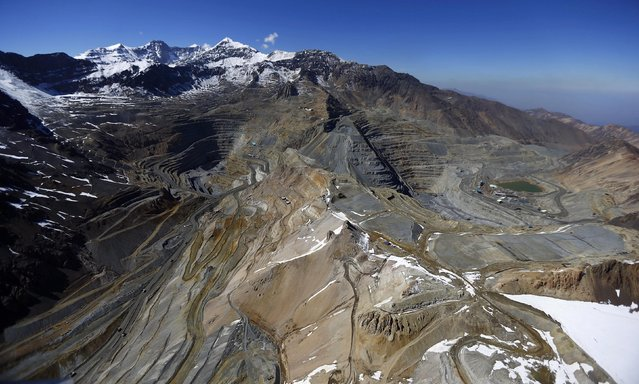 An aerial view of open pits of CODELCO's Andina (L) and Anglo American's Los Bronces copper mines with Olivares glaciers in the background (top L) at Los Andes Mountain range, near Santiago city, November 17, 2014. The rock glaciers of the Chilean central zone, a huge source of water for the basins of the capital, are said to be threatened by the environmental impacts of hydroelectric and mining projects, according to environmental activists Greenpeace. (Photo by Ivan Alvarado/Reuters)