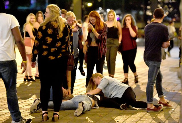 Giggles all round as a Portsmouth reveller falls over, presumably from too much to drink, as a friend tries to rally them to get up in Portsmouth, Hampshire on September 21, 2016. (Photo by Paul Jacobs/PictureExclusive.com)