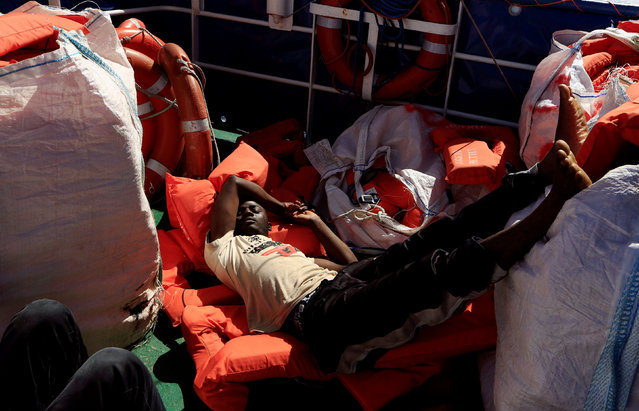 A migrant rests onboard of Iuventa vessel after being rescued from an overcrowded dinghy by members of the German NGO Jugend Rettet during an operation, off the Libyan coast in the Mediterranean Sea September 21, 2016. (Photo by Zohra Bensemra/Reuters)