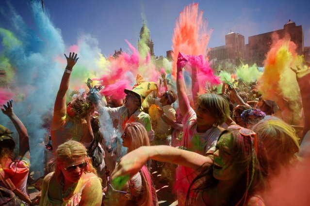 Revellers are covered in coloured cornflour powder as they take part in the Holi One festival in Cape Town, March 2, 2013. The event is inspired by the Hindu Holi spring festival of colour which originated in India. (Photo by Mark Wessels/Reuters)