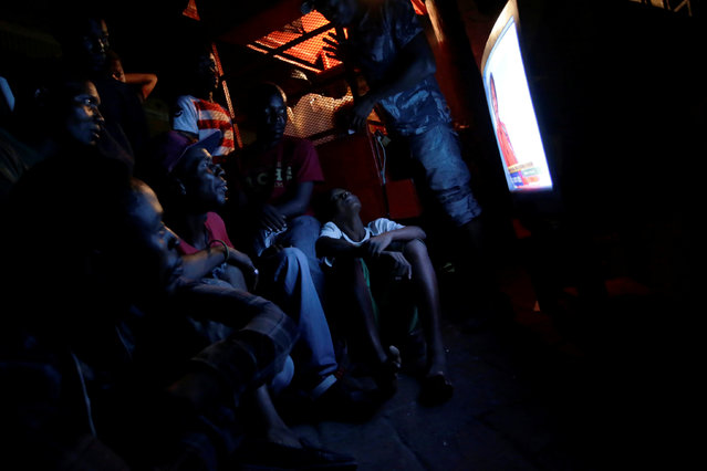 Residents attend the broadcasting of an electoral debate on the street of Port-au-Prince, Haiti, September 20, 2016. (Photo by Andres Martinez Casares/Reuters)