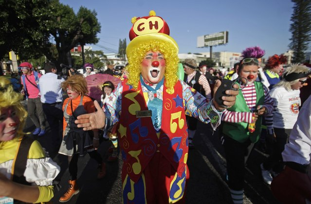Salvadorean clowns take part in National Clown Day celebrations at Beethoven Square in San Salvador December 3, 2014. (Photo by Jose Cabezas/Reuters)